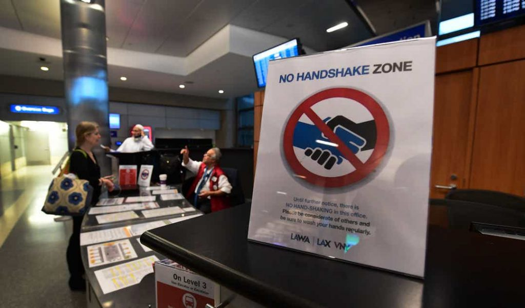 Notice on no handshake zone, to protect employees at Los Angeles International Airport.