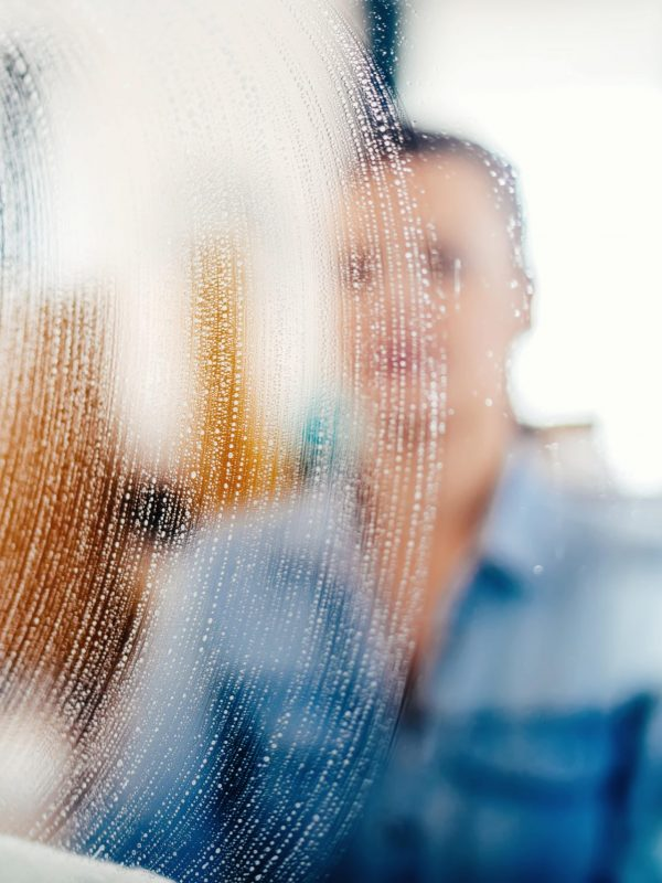 close-up-portrait-blurred-out-details-of-window-cl-PU2JHVX-min