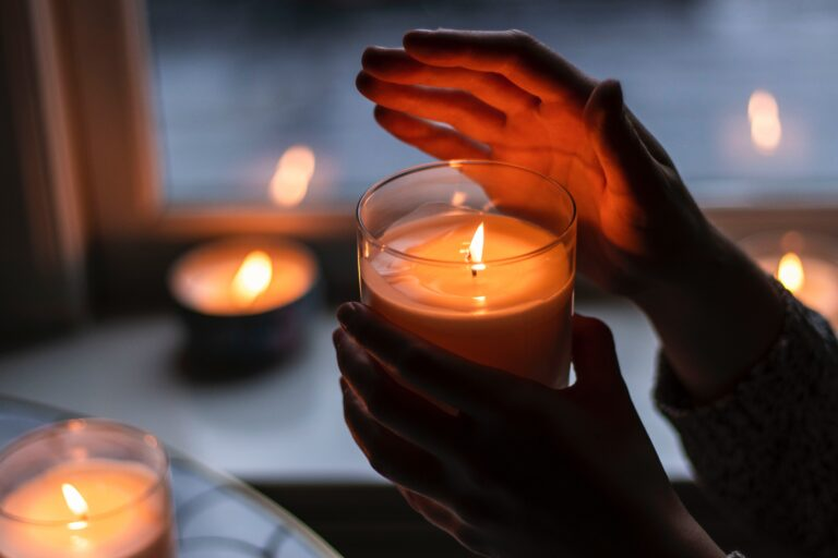 Hands holding candle, for helpul links page