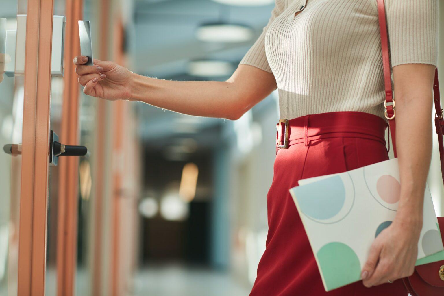 Businesswoman opening the door
