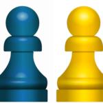 Vier pionnen in rood, blauw, geel en groen