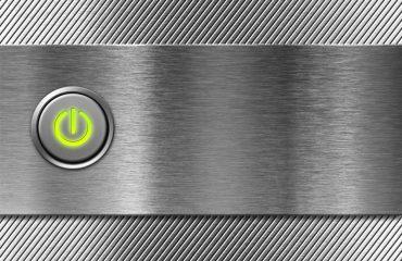 Begin: aan/uit knop op metalen achtergrond