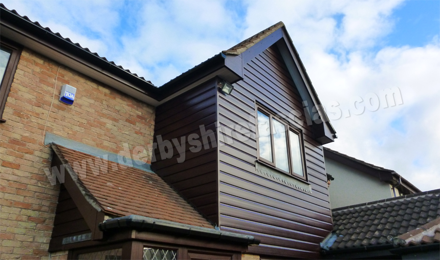 Rosewood PVCu Cladding by Derbyshire Fascias