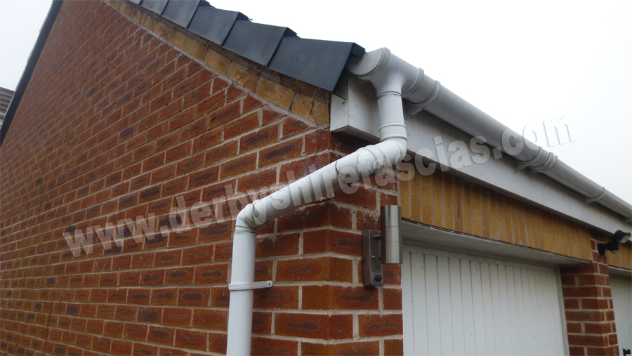 Unconventional way to install a down pipe!