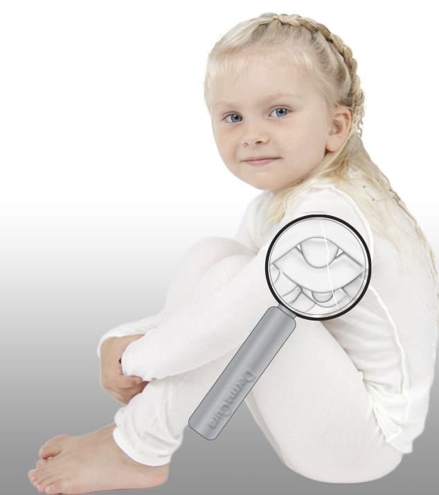 Image of girl wearing DermaCura eczema clothing with magnifier of smooth fibres