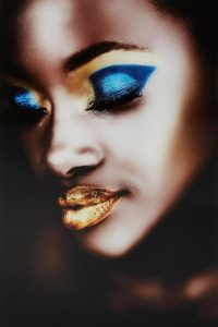 African woman with golden lips
