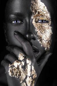 Dark-skinned girl with gold