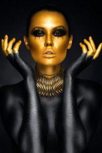 Beautiful woman in gold & black