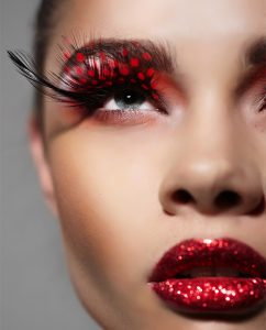 Close-up woman face with Creative Fashion Art make up and eyelashes