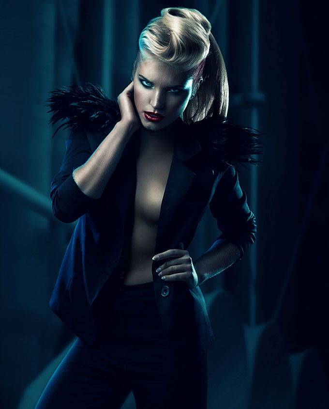 Blonde woman in blazer with feather