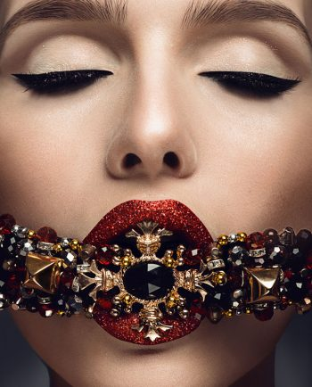 Jewelry model with gold. perfect make-up and red lips