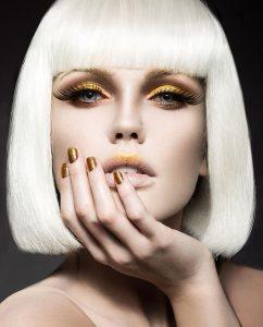 Plexiglas schilderij - Beautiful girl in a white wig with golden make-up