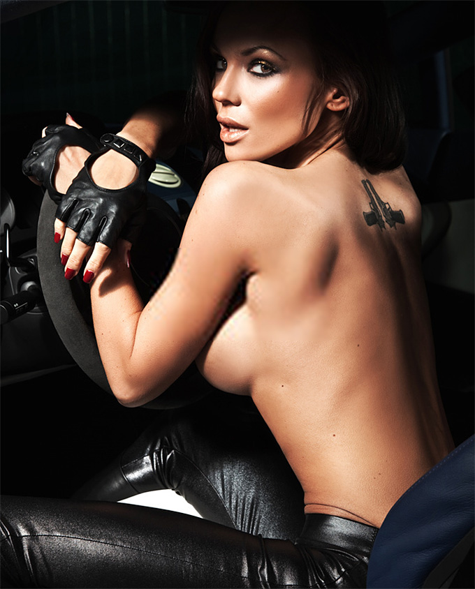 Sexy young lady sitting in a sportscar
