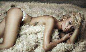 Beautiful blonde beauty on a carpet