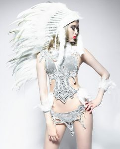 Native American girl with feather and bow in an sexy outfit