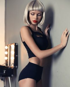 beautiful sexy girl with short blond wig in black lingerie