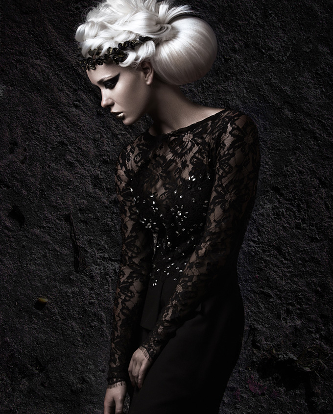 Beautiful girl in gloomy image with a white wig