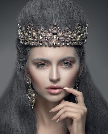 Portrait of a beautiful woman wearing a diamond crown and earrings