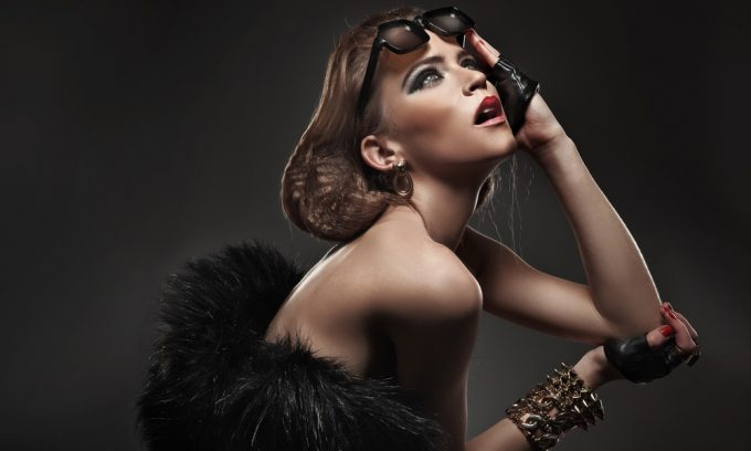 Glamorous woman with glasses wearing fur