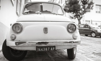 Old white fiat 500 L city car