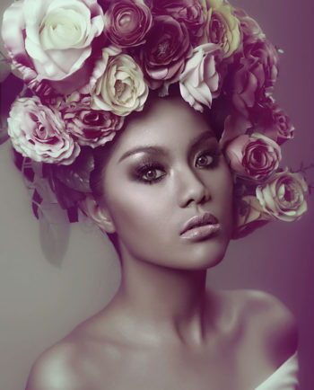 Beautiful woman with roses on her head