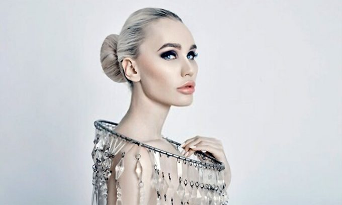 Fashion art portrait of a blonde with a big shiny necklace