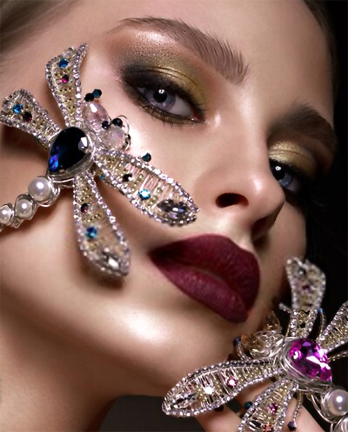 Girl with bright makeup and designer accessories