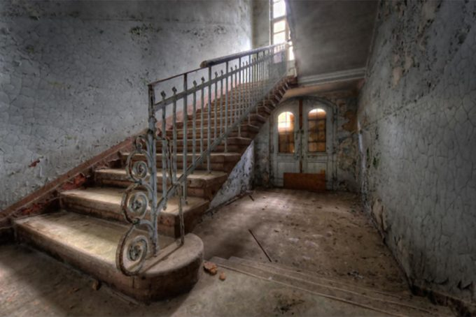 Old stairs in a decayed sanatorium