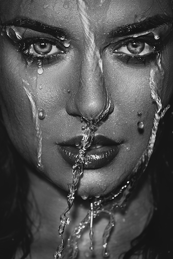 Wet woman face with water drops