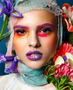 portrait with fashionable make-up of a girl in flowers