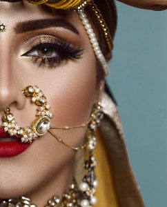 female Indian model in traditional ethnic Asian bridal costume