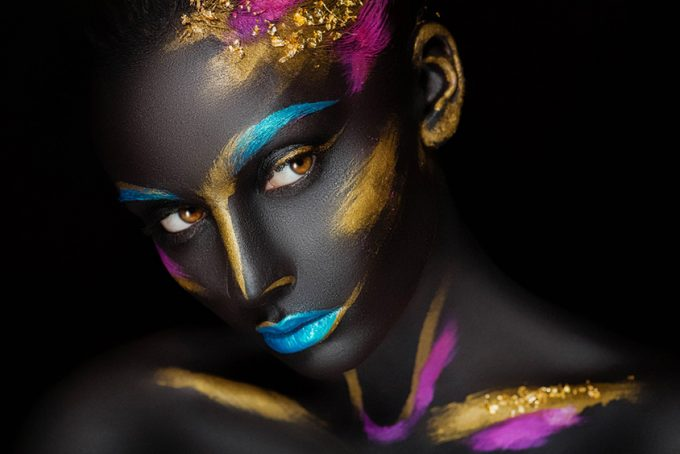 Portrait of a dark-skinned girl with color make-up