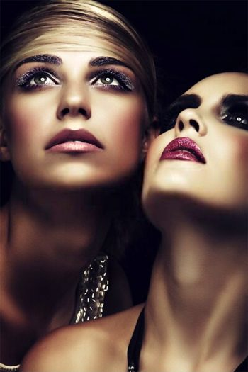 two beautiful young women with dark evening makeup