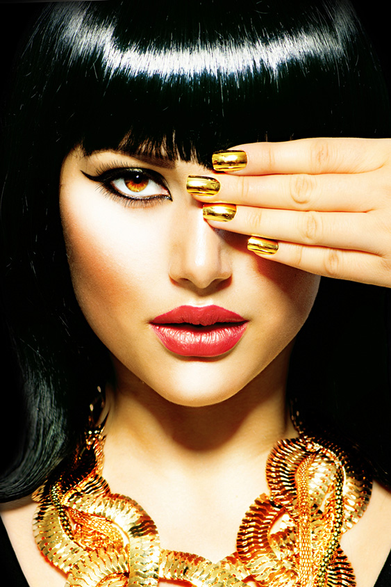 Beauty Brunette Egyptian Style Woman with Gold