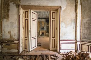 Abandoned manor house interior living room with rotten floors