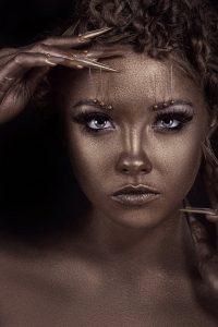 Model girl with bronze skin