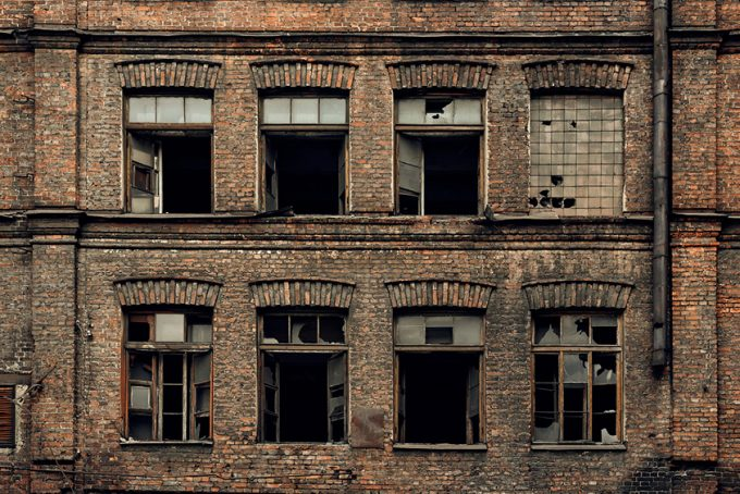 Brick facade of an abandoned old building