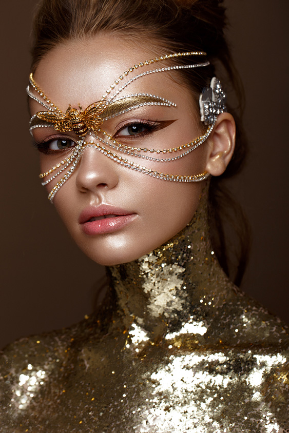 Beautiful girl in a golden mask