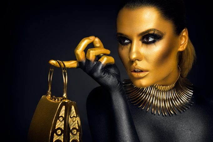 woman portrait in gold and black colors