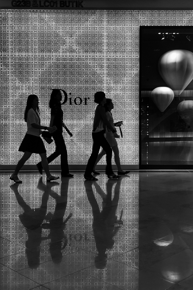 Shoppers passing by Dior Boutique