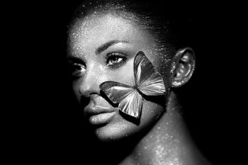 Beautiful woman with sparkles and butterfly