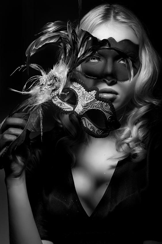 woman in black half mask