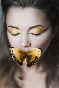 woman with a butterfly on her lips