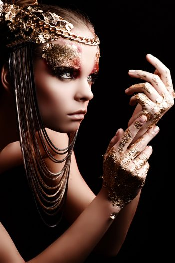 Beautiful woman with golden make-up