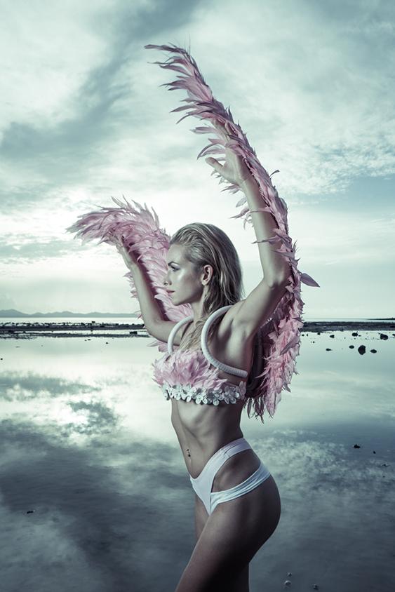 beauty as an angel on the beach