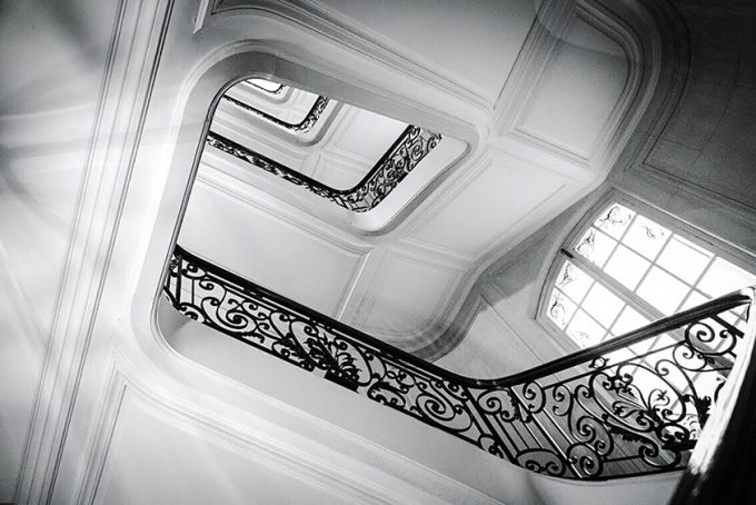 luxury staircase with wooden railings
