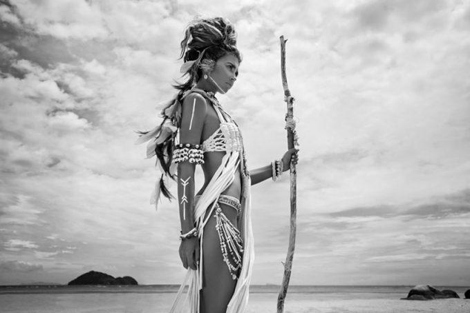 wild boho woman at beach
