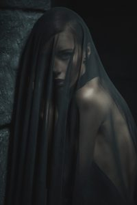 woman in mourning black veil