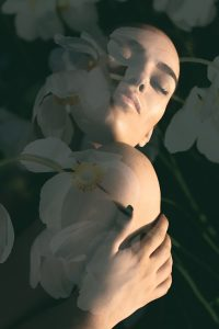 lady combined with photograph of white flowers