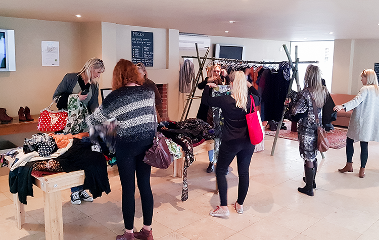 People shop the clothing donated by danish designers at the Fashion Fundraiser event in South Africa